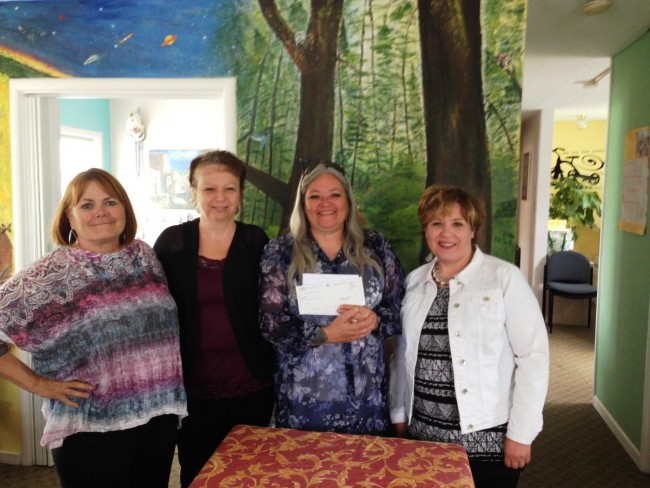 Diane Schaff, Teresa Johnson, Melody Brown present check to YES Coordinator Jamie Zachary